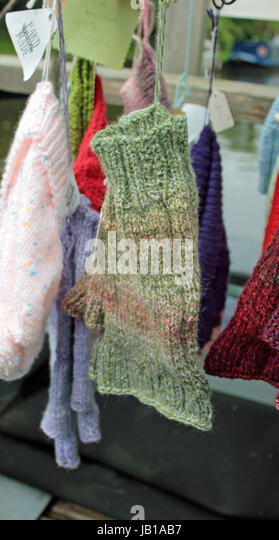 A lovely soft hand knitted pair of fingerless gloves that would be ideal for gardening, typing, mechanicing, It - Stock Image