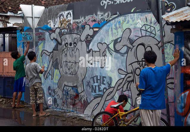 Mural painting child stock photos mural painting child for Mural jakarta