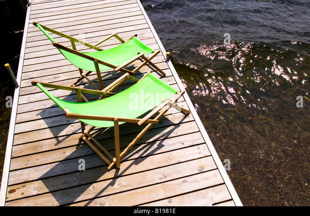 Green Sun Chairs On A Boat Dock, North Hatley, Quebec, Canada   Stock