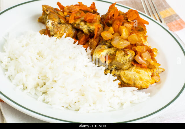Fish rice and carrots stock photos fish rice and carrots for Baked fish and rice