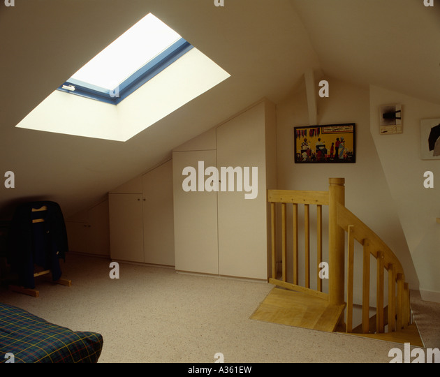 Cream Carpet In Sparsely Furnished Loft Conversion Bedroom