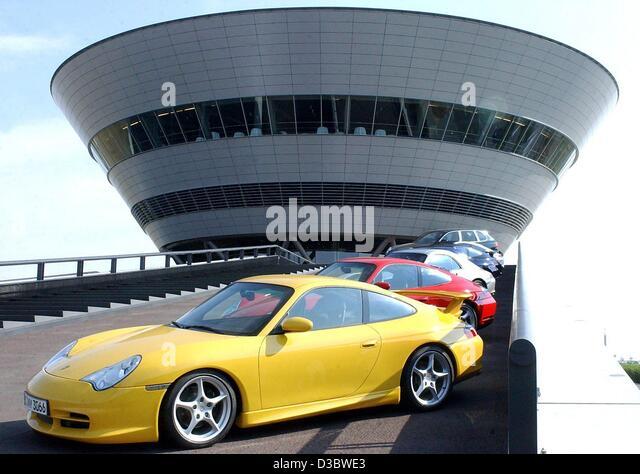 (dpa)   A Yellow Porsche Carrera GT Stands In Front Of The Porsche Factory