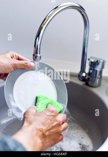 Kitchen Sink With Clean Dishes man washing dishes plates stock photos & man washing dishes plates