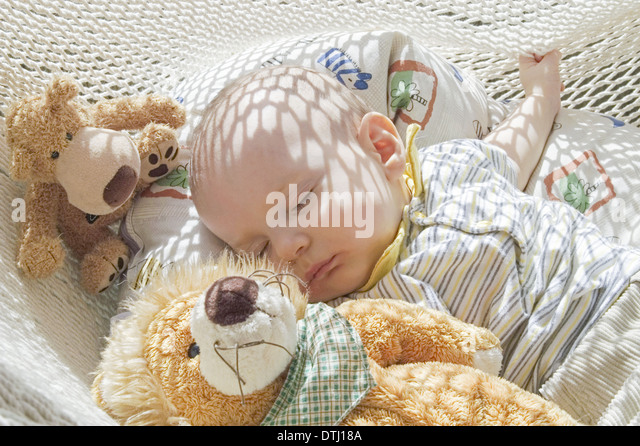 baby with soft toys sleeping in hammock  model released    stock image baby with soft toys sleeping hammock stock photos  u0026 baby with soft      rh   alamy
