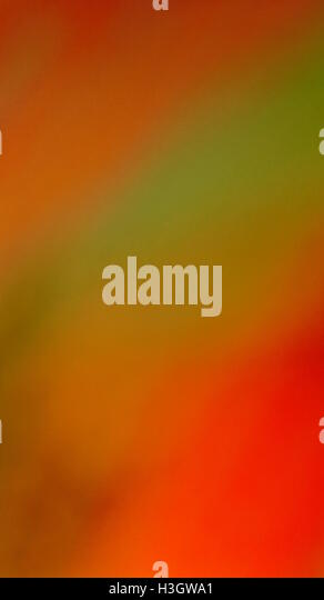 Warm pastel coloured abstract merging background. - Stock Image