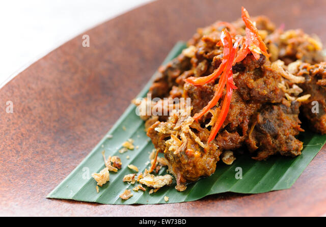 Indonesian Beef Rendang Garnished With Fried Shallots And Red Chillies Stock Image
