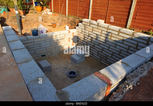 Koi pond stock photos koi pond stock images alamy for Koi pool construction