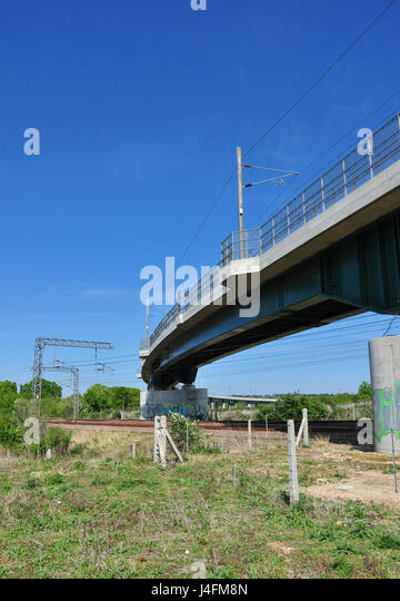 Railway flyover for the Cambridge route crosses the East Coast main Line, Hitchin, Hertfordshire, England, UK - Stock Image