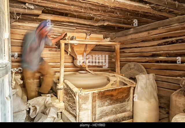 Working corn mill stock photos working corn mill stock images man working in a small mill man making corn flour wooden water mill interior ccuart Images