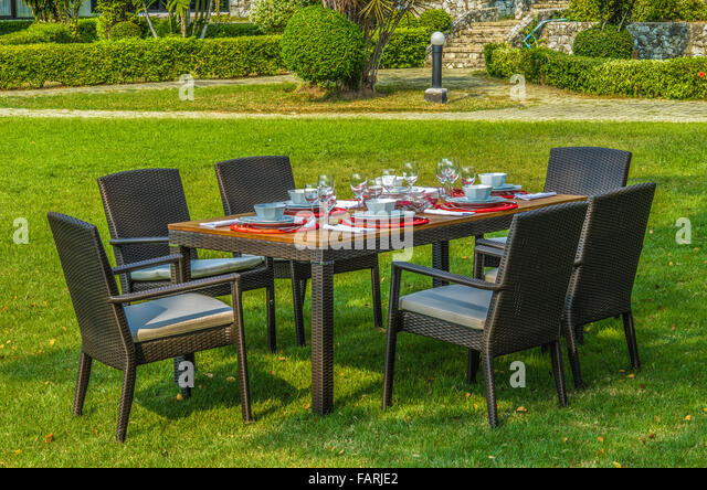 Rattan Garden Table And Chairs With Water Resistant Outdoor Cushions    Stock Image