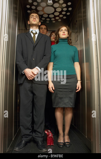people inside elevator. group of business people standing in elevator - stock image inside e