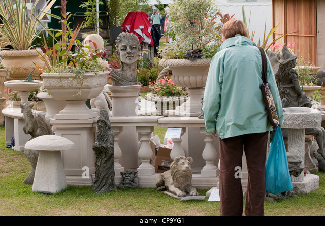 RHS Flower Show, Tatton Park, Cheshire   A Lady Browsing Garden Ornaments  At One