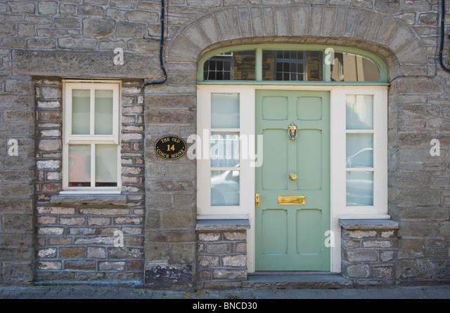 Brass door knocker uk stock photos brass door knocker uk for Domestic front doors