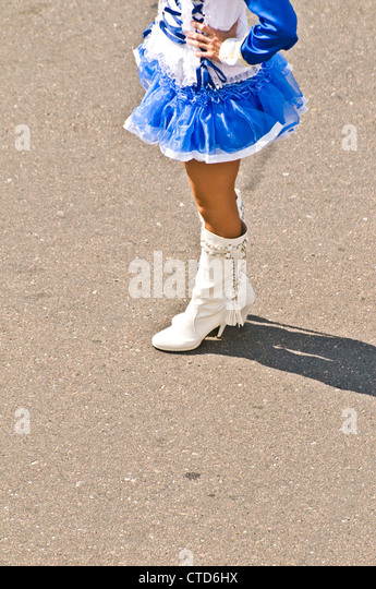"""performance and majorette These female groups refer to themselves as majorettes and battle  this style  of majorette performance is a distinct change from the """"old."""