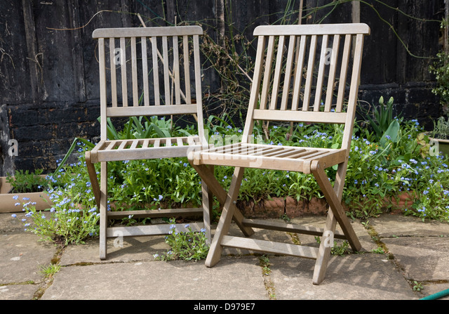 two wooden garden chairs next to each other stock image - Garden Furniture Next Day Delivery