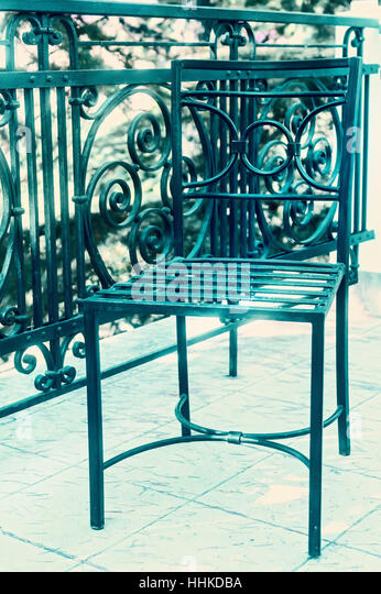 Cast Iron Chair On Balcony In Sepia Light   Stock Image