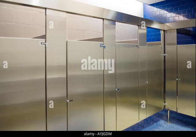 public bathroom stalls all occupied stock image