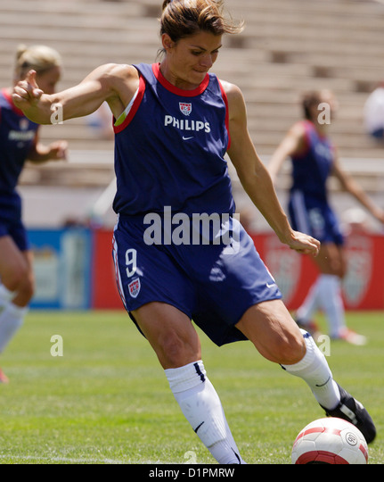 mia hamm of the united states kicks the ball during warmups before a friendly soccer match