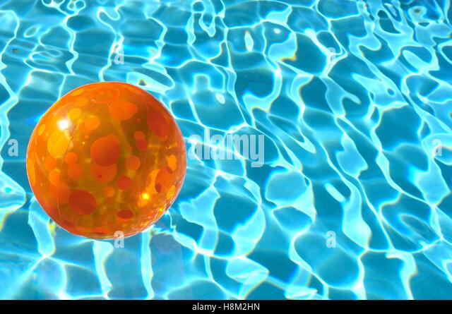 Beach Ball In Water beach ball floating water stock photos & beach ball floating water