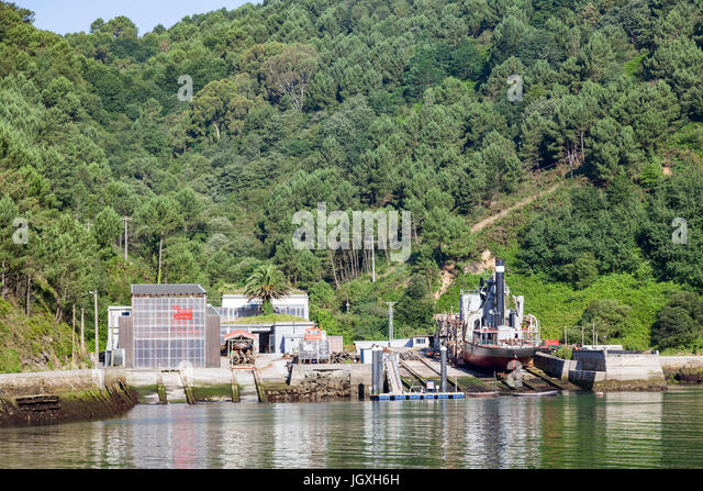 A bucket dredging ship in dry dock in the fjord of Pasajes (Guipuzkoa - Spain).  Pasajes (or Pasaia) is the San - Stock Image