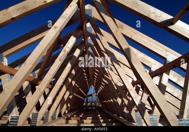 Prefabricated roof trusses stock photos prefabricated for Prefabricated wood trusses