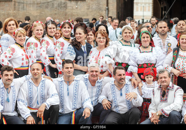 romanian people. romanian people wearing traditional blouse \u0027ie\u0027 celebrating the international day of m