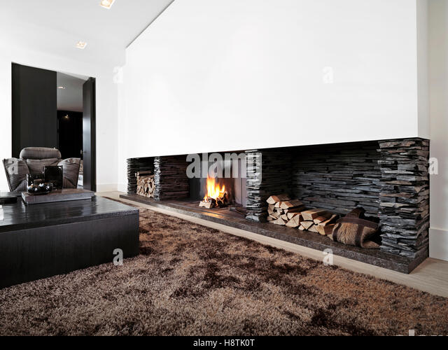 Modern Livingroom With Large Fireplace Black Furniture
