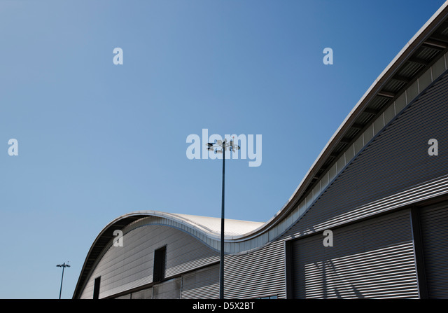 Marvelous Curved Roof Of Warehouse And Blue Sky   Stock Image