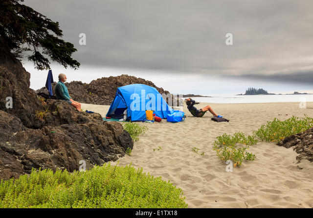 Two kayakers relax at their c&site on Whaler Islet off the British Columbia coast Canada & Campsite With Tent And Model In The Background Stock Photos ...