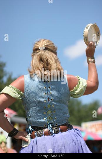 florida zydeco festival cajun music woman tambourine percussion stock