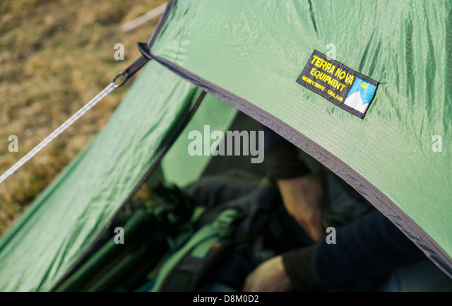 A close up of a Terra Nova Solar 2 tent pitched with hands packing a backpack & Terra Nova Tent Stock Photos u0026 Terra Nova Tent Stock Images - Alamy