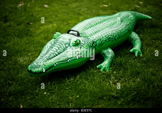 Inflatable Crocodile Series Suburban Menace   Stock Image