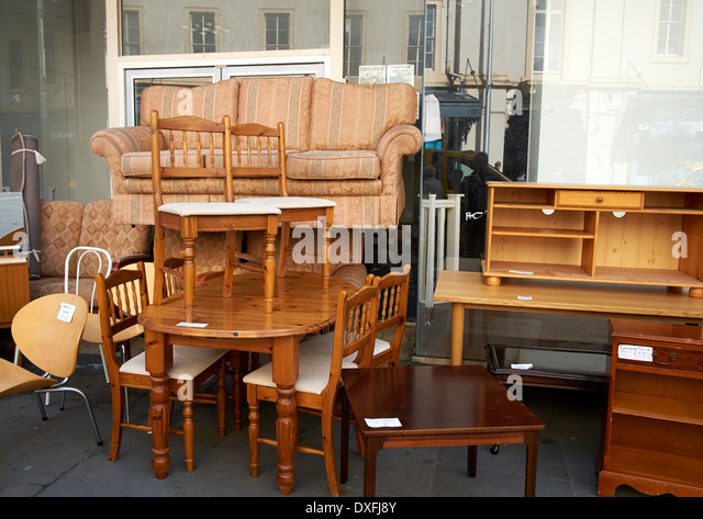 Used second hand furniture on sale on a UK high street - Stock Image