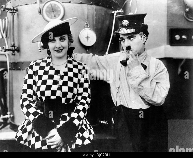 Edna Purviance And Charlie Chaplin On Set Of The Film, The Fireman, 1916