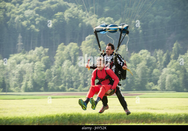 A tandem master coming in for landing with his passenger - Stock Image
