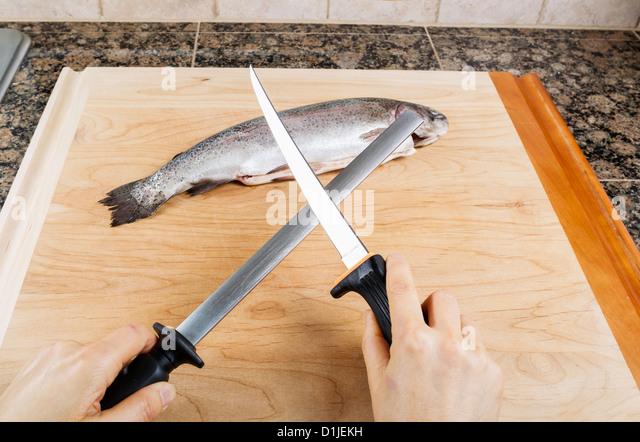 Sharp knife fish cutting stock photos sharp knife fish for Fish cutting board