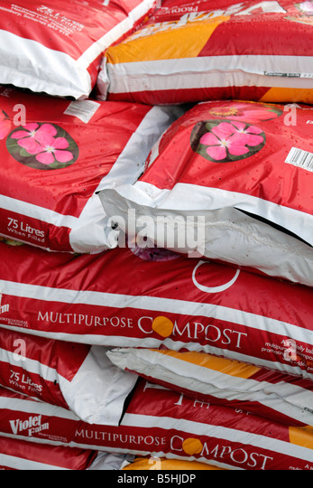compost bags for sale in garden centre stock image