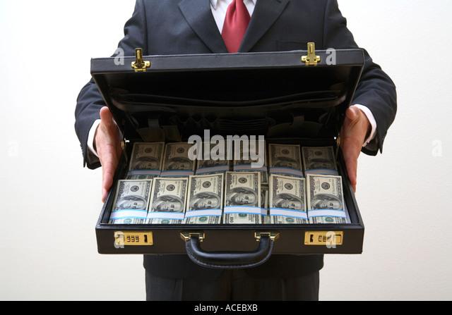 briefcase cash stock photos briefcase cash stock images alamy. Black Bedroom Furniture Sets. Home Design Ideas