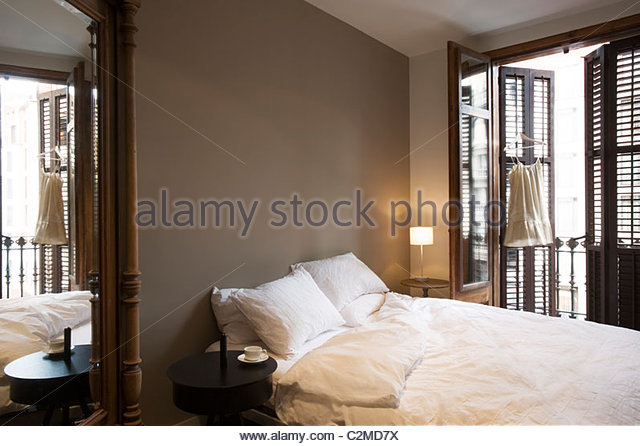 Monochrome Bedroom With Full Length Plantation Shutters   Stock Image
