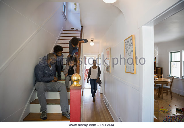 Family On Stairs And In Hallway   Stock Image