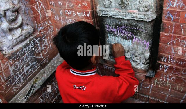 A Nepalese Boy Writes His Name On