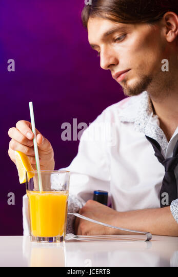 Young Stylish Man Bartender Preparing Serving Alcohol Cocktail Drink Over  Bar Counter   Stock Image