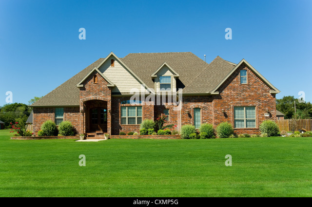 Two story brick house landscaped lawn stock photos two for Beautiful two story homes