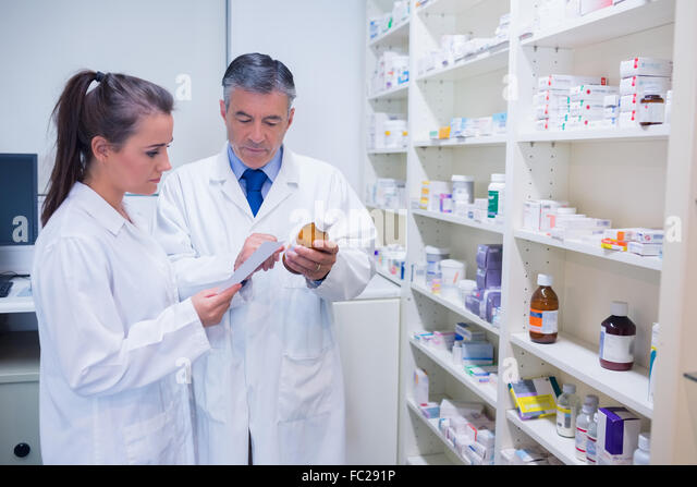 pharmacist and trainee talking together about medication stock image - Pharmacist Trainee