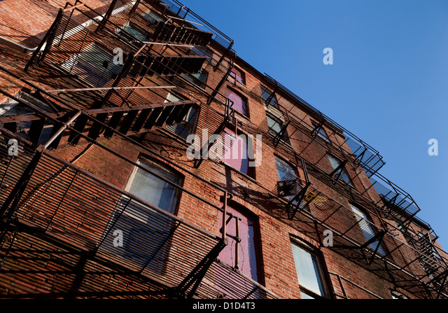 Fire Escape Stairs On An Old Brick Apartment Building   Stock Image
