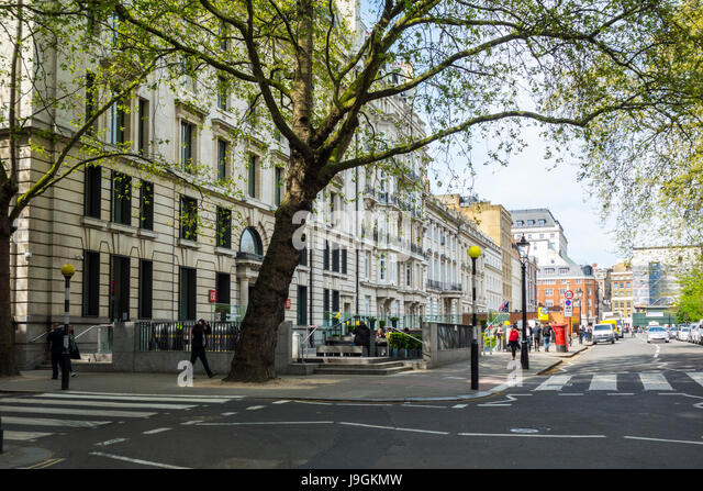 Pedestrian crossings on Lincoln's Inn Fields looking towards the LSE Department of Law, City of London, UK - Stock Image