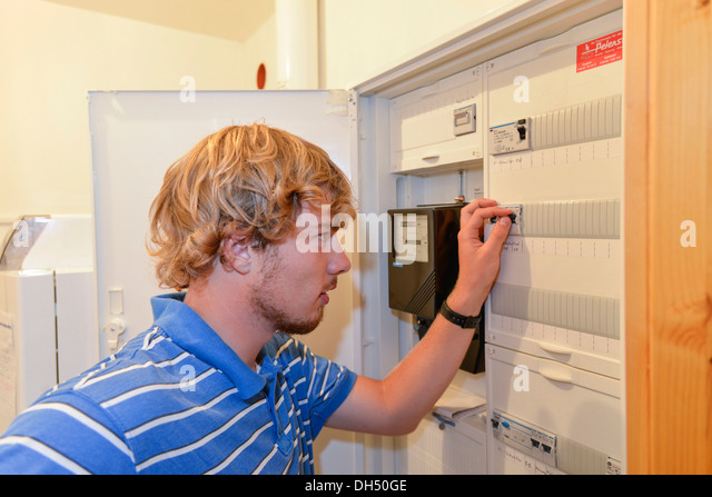ge fuse box fuse boxes stock photos fuse boxes stock images alamy young man turning off a fuse in