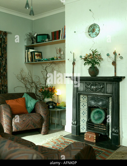 Amchair Beside Edwardian Cast Iron Fireplace In Nineties Living Room