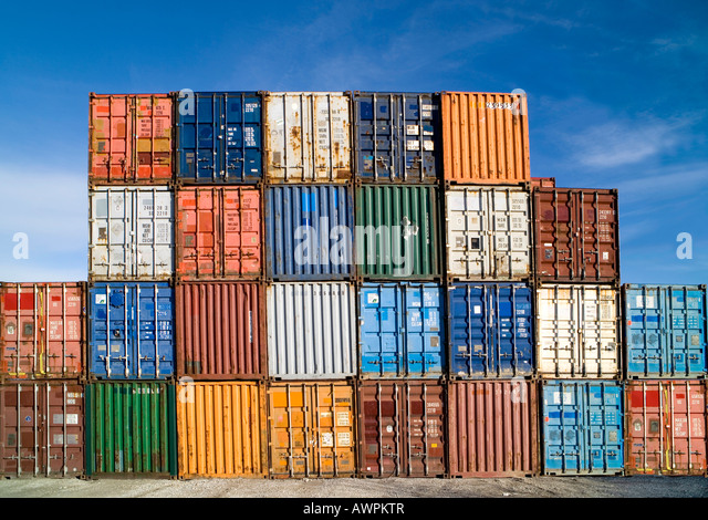 Various shipping containers, stacked - Stock Image