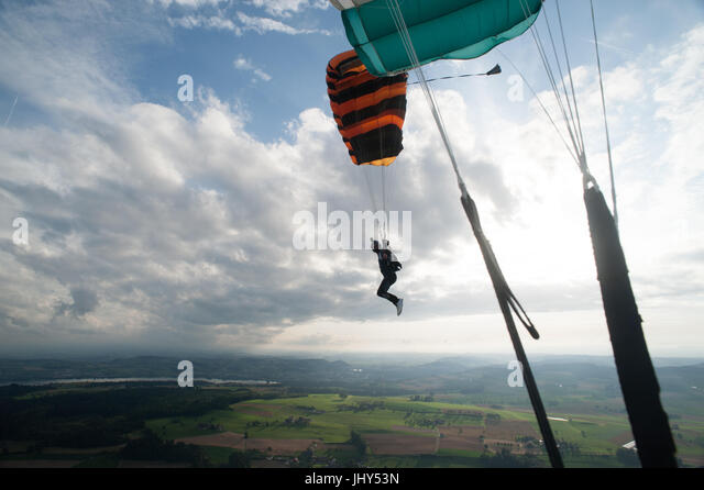 Skydiver flying towards the landing zone at Beromunster airport in Switzerland - Stock Image